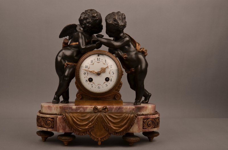 French gilt bronze mantle clock with Cherubs on each
