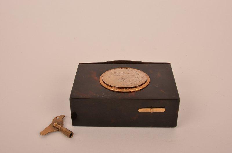 Tortoise shell mechanical singing bird box.
