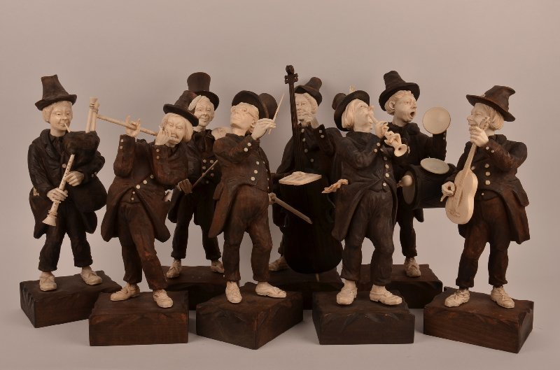 Eight piece German carved wood and ivory marching band,