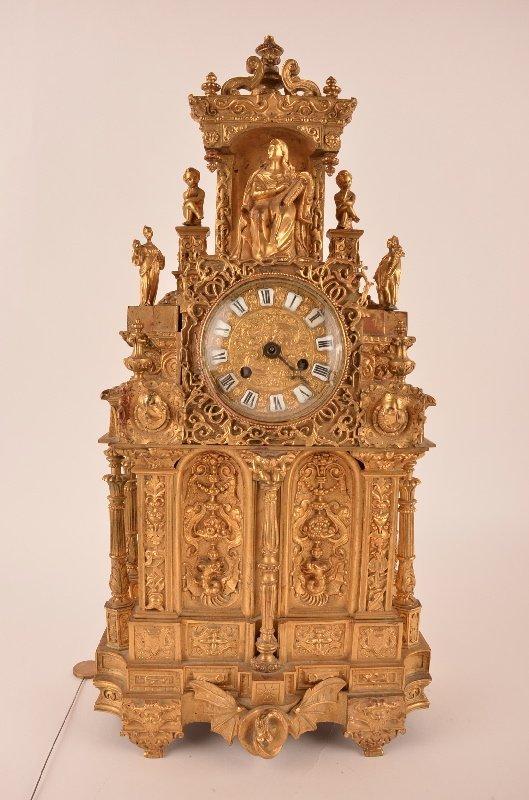 19 th century French ormolu mantel clock with a silk