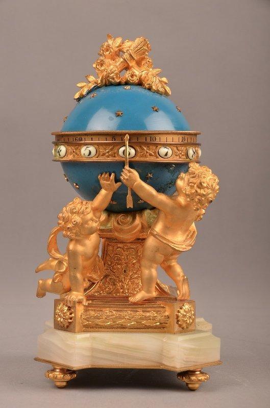 Blue enamelled and gold gilt bronze annular clock.