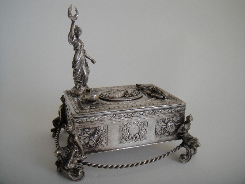 Sterling silver singing bird box with a woman holding a