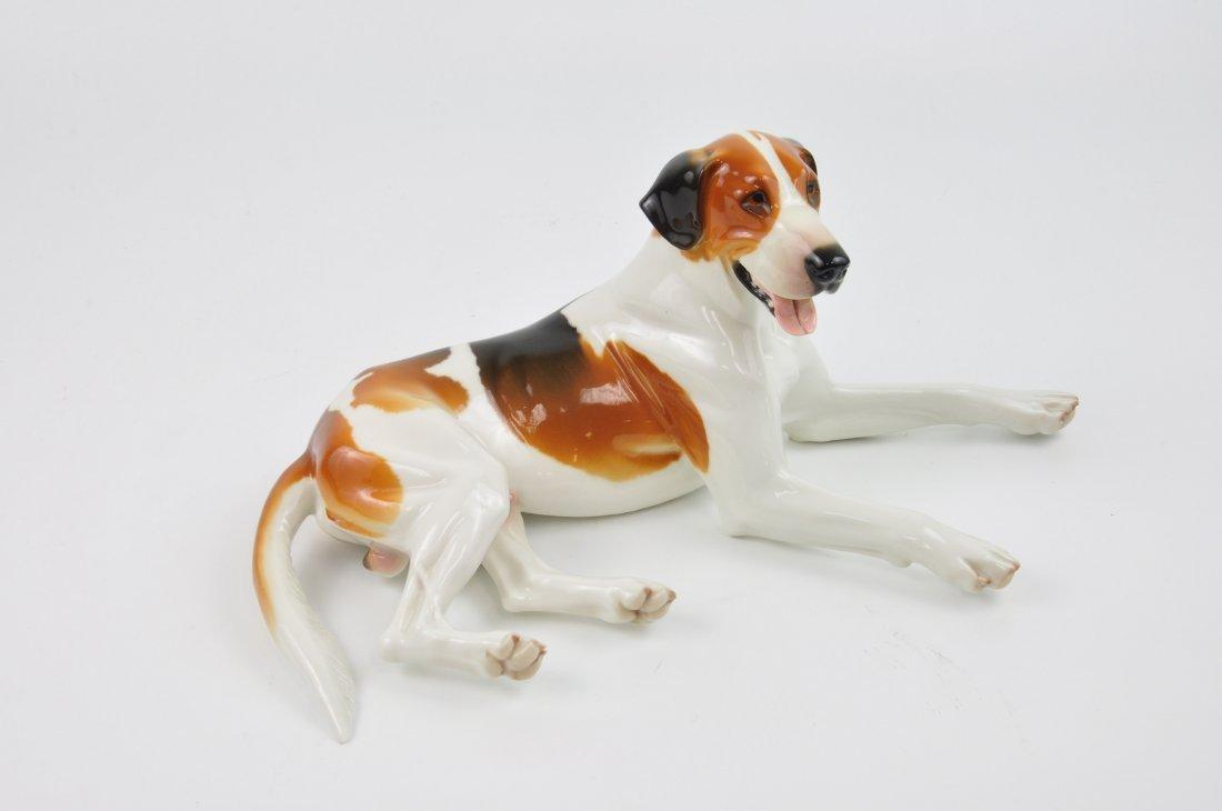 Nymphenburg German porcelain figurine of a dog laying