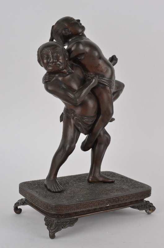 Japanese bronze figurine of two Sumo wrestlers in
