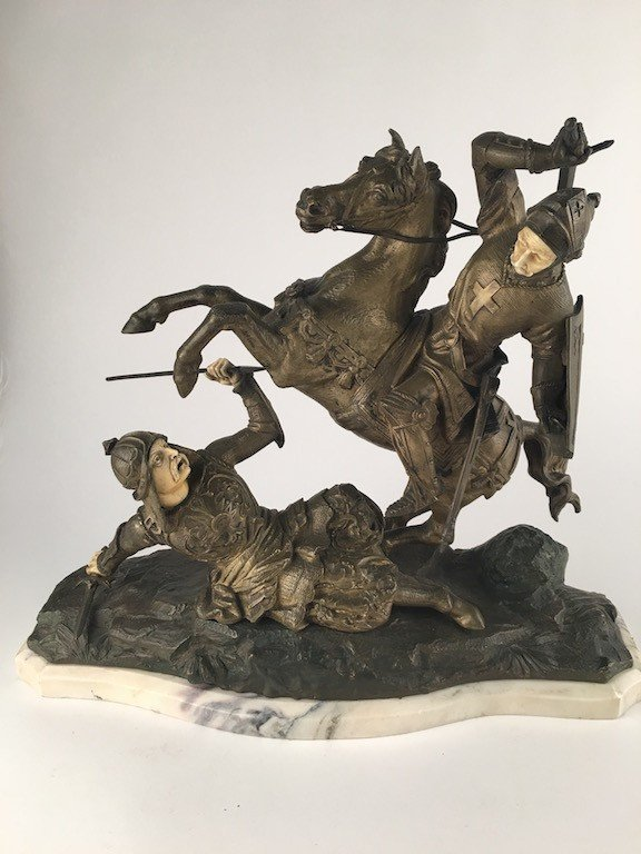Gerreros Sculpture of two Knights fighting,