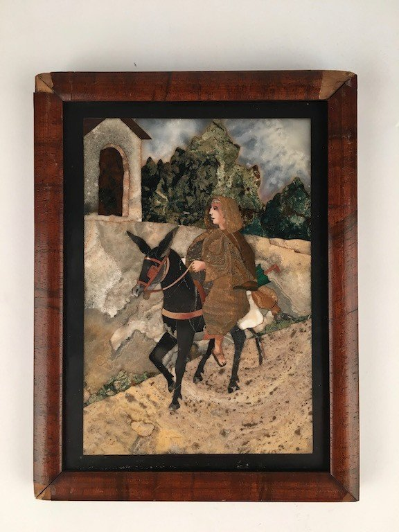 Pietra dura plaque of a lady riding on a donkey.
