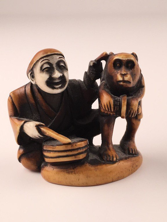 Carved Japanese Netsuke figure of a man and monkey with