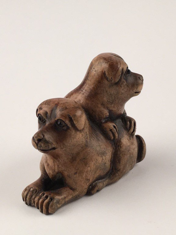Carved Japanese Netsuke figure of two Dogs.
