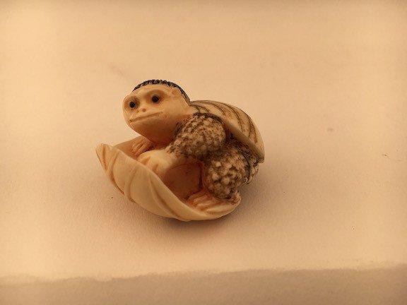 Carved netsuke figure.
