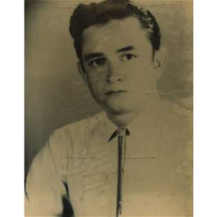 PHOTOGRAPH OF A YOUNG JOHNNY CASH