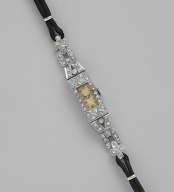 258: LADY'S PLATINUM AND DIAMOND WRISTWATCH,