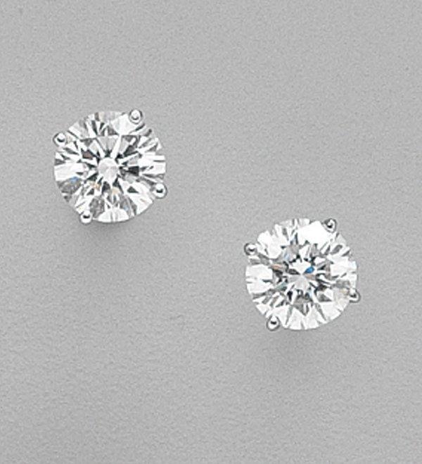 440: PLATINUM AND DIAMOND STUD EARRINGS 2 rou