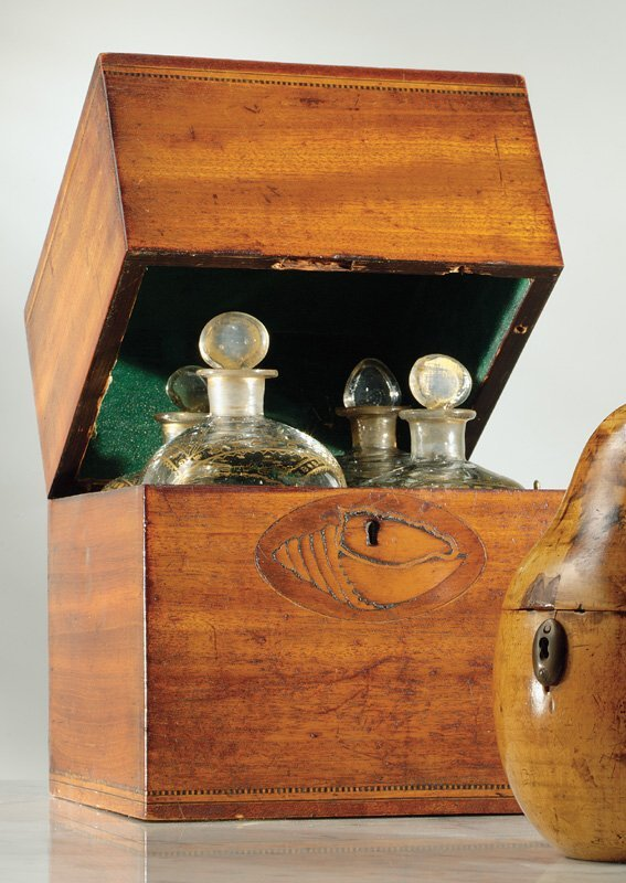 1: A George III inlaid mahogany decanter box with four