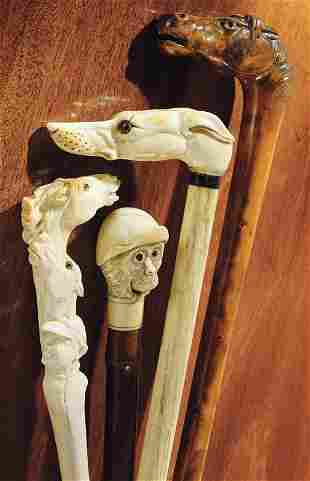 An ivory walking stick and an ivory riding crop