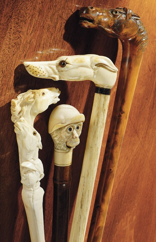 4: An ivory walking stick and an ivory riding crop