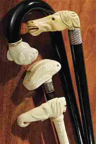 Four ivory-handled walking sticks
