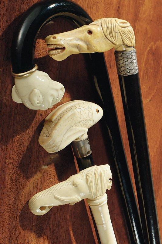6: Four ivory-handled walking sticks