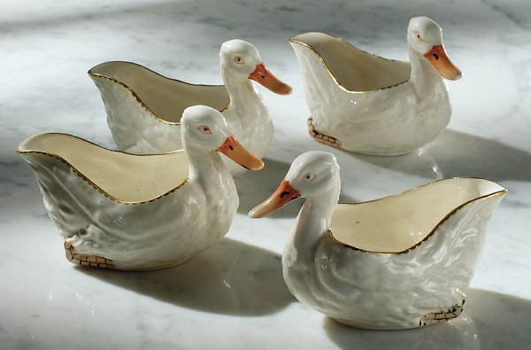 9: A SET OF FOUR DERBY PORCELAIN DUCK-FORM SMALL SAUCEB