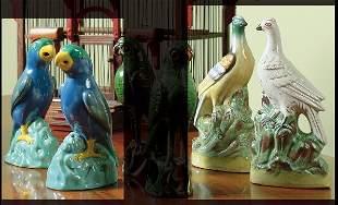A pair of Mintons majolica figures of parrots circa