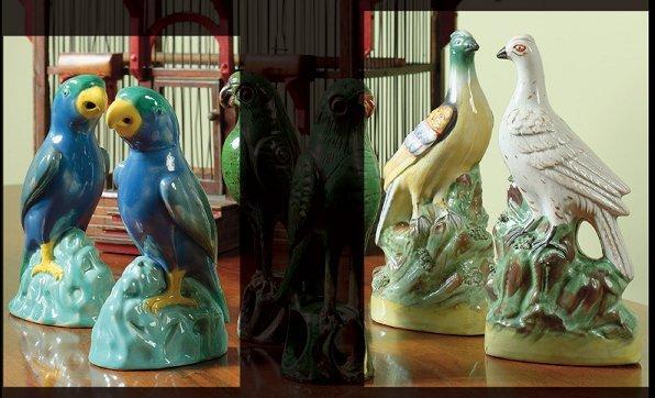 10: A pair of Mintons majolica figures of parrots circa