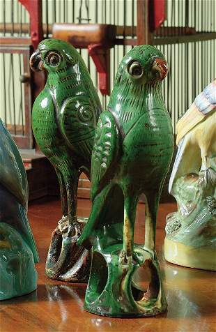 A pair of Chinese Export green-glazed biscuit figur
