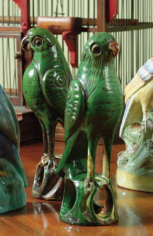 11: A pair of Chinese Export green-glazed biscuit figur