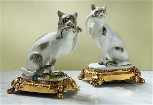 An assembled pair of Meissen figures of seated cats