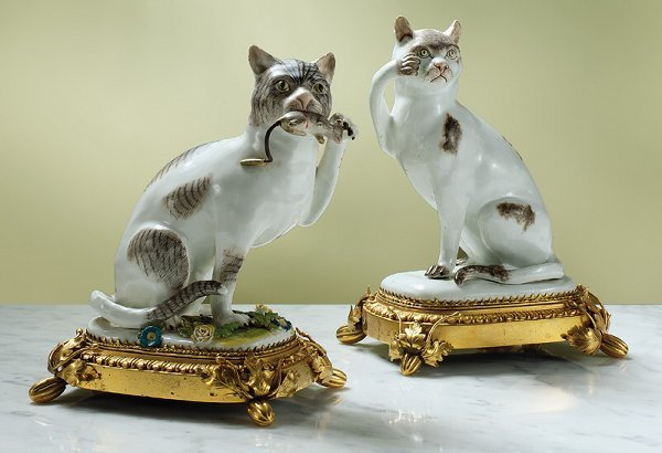 17: An assembled pair of Meissen figures of seated cats