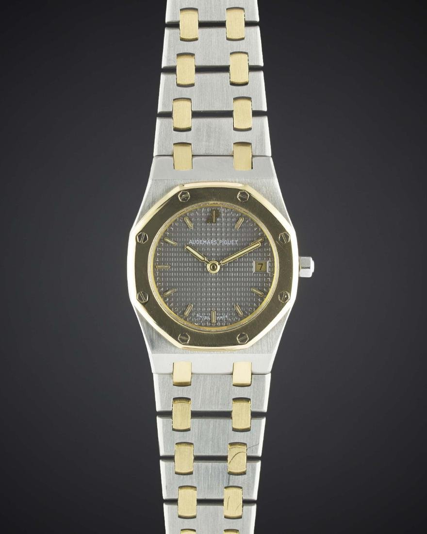 A LADIES STEEL & GOLD AUDEMARS PIGUET ROYAL OAK