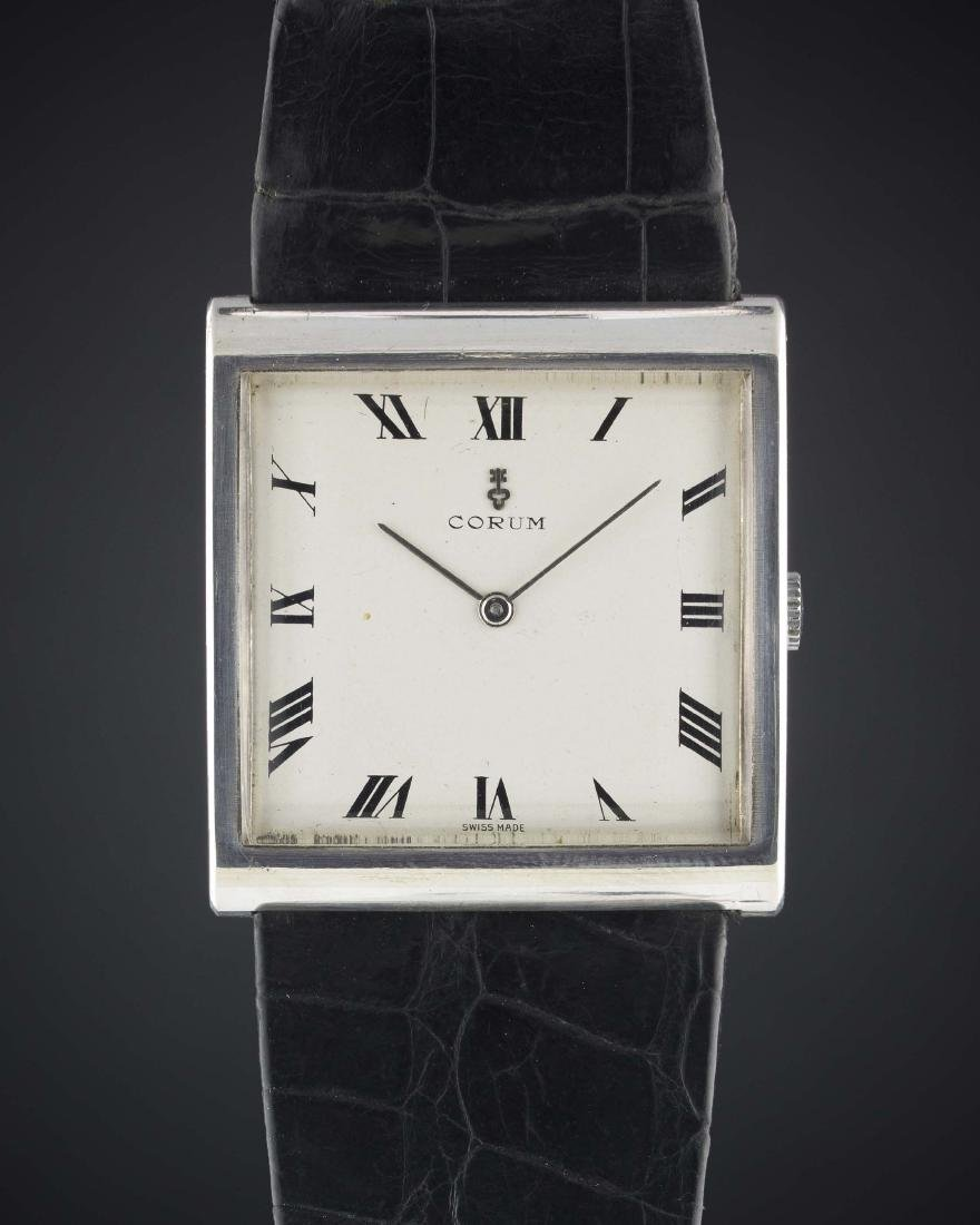 A GENTLEMAN'S LARGE SIZE SOLID SILVER CORUM BUCKINGHAM