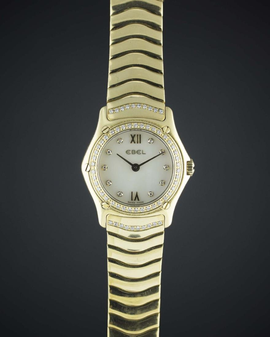 A LADIES 18K SOLID GOLD & DIAMOND EBEL 1911 BRACELET