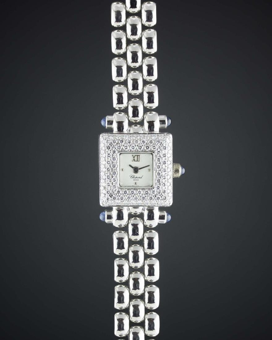 A LADIES 18K WHITE GOLD & DIAMOND CHOPARD BRACELET