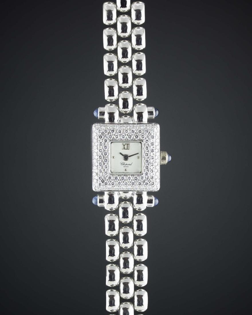 A LADIES 18K WHITE GOLD & DIAMOND CHOPARD BRACELET
