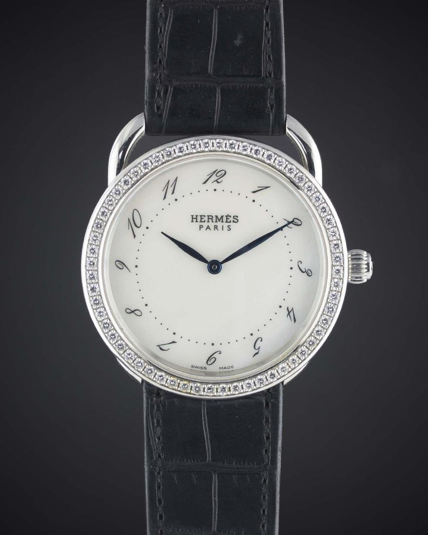 A LADIES STAINLESS STEEL & DIAMOND HERMES ARCEAU WRIST