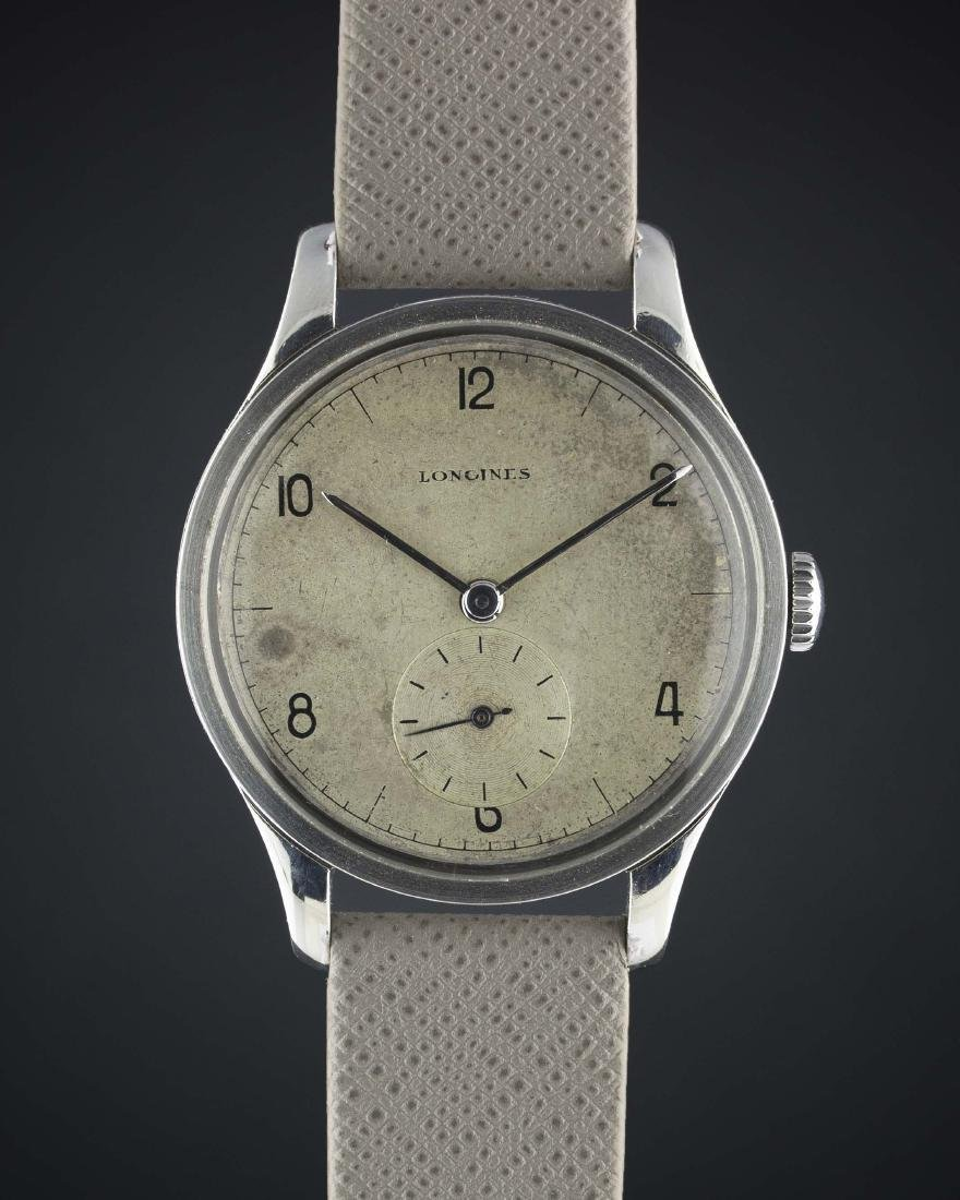 A RARE GENTLEMAN'S LARGE SIZE STAINLESS STEEL LONGINES