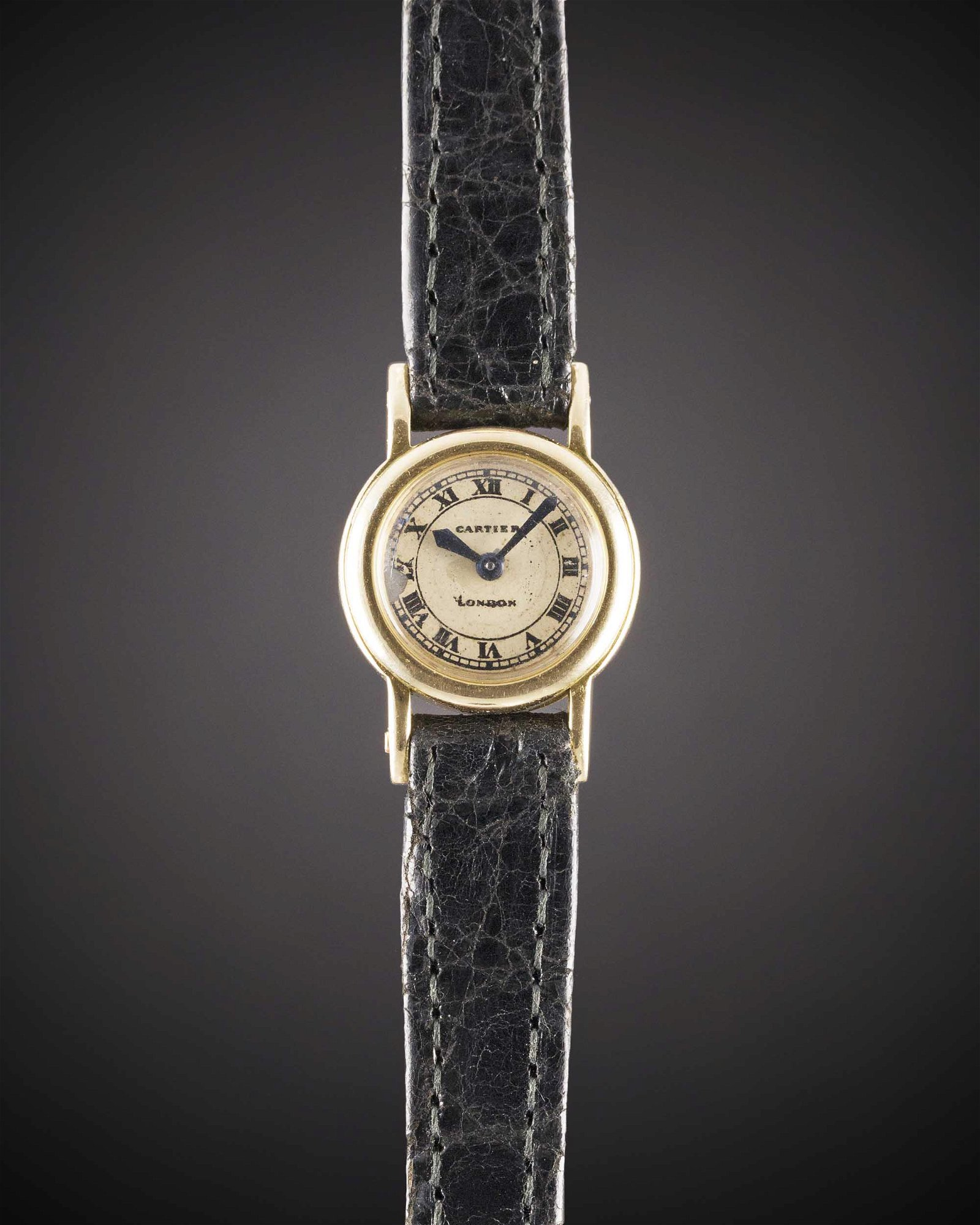 A RARE LADIES 18K SOLID GOLD CARTIER LONDON BACKWIND