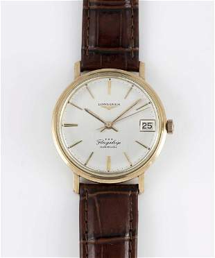 A GENTLEMAN'S 9CT SOLID GOLD LONGINES FLAGSHIP