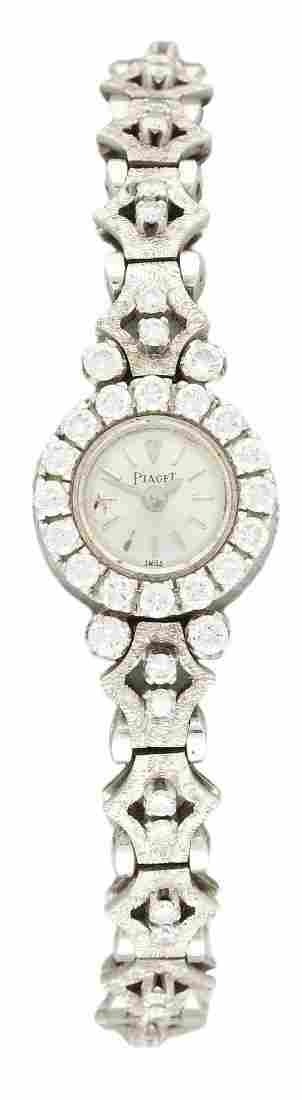 A LADIES 18K SOLID WHITE GOLD & DIAMOND PIAGET BRACELET