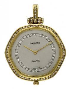 A GENTLEMAN'S 18K SOLID GOLD & DIAMOND GARRARD PENDANT