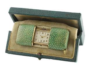 A LADIES SOLID SILVER GILT & SHAGREEN COVERED MOVADO