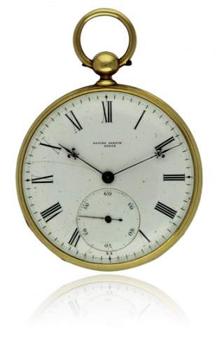 AN 18K SOLID GOLD KEY WIND RACINE GENEVE PIVOTED DETENT