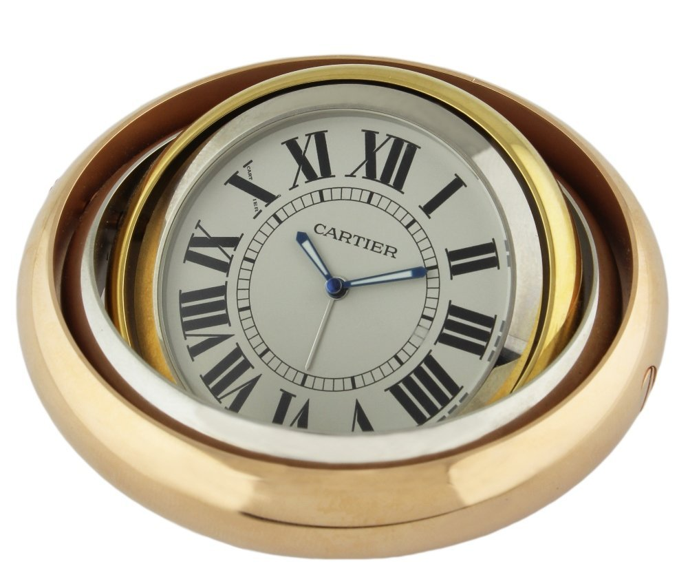 A TRINITY DE CARTIER TRI-COLOUR ALARM DESK CLOCK CIRCA