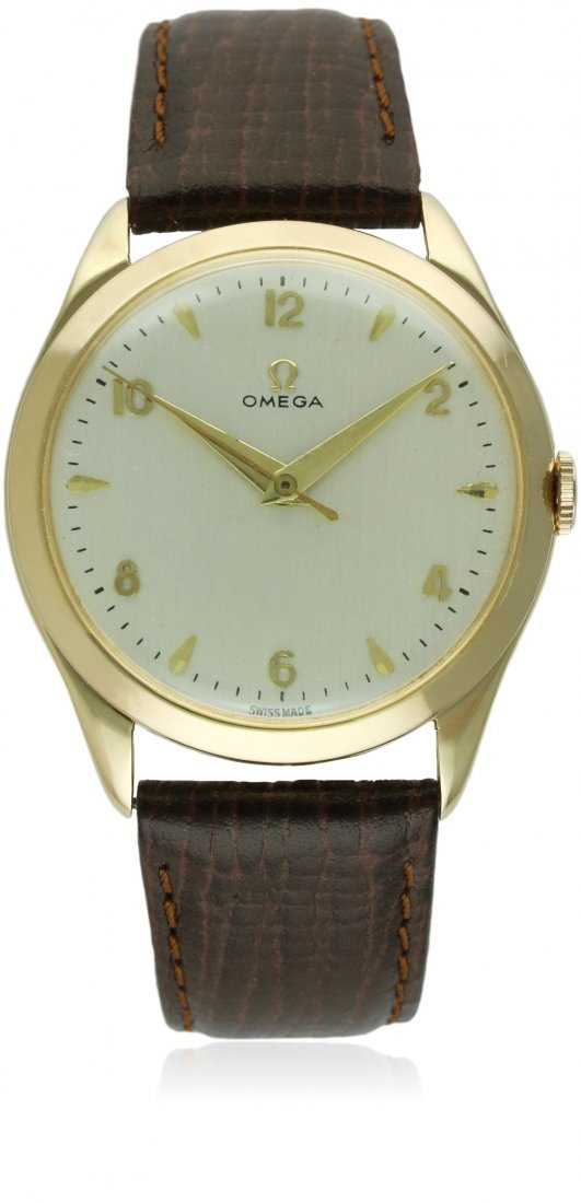 A GENTLEMAN'S LARGE SIZE 14K SOLID GOLD OMEGA WRIST