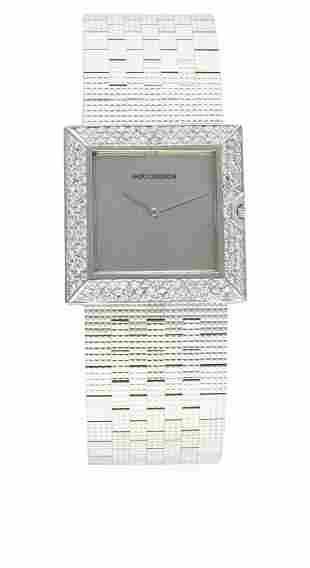 A FINE GENTLEMAN'S 18K SOLID WHITE GOLD & DIAMOND