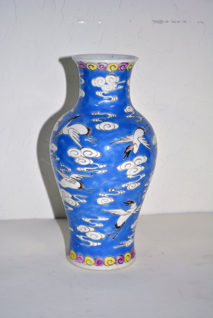 Blue vase with white cranes