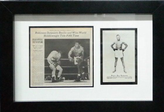 Dedicated signed photo by sugar Ray Robinson.