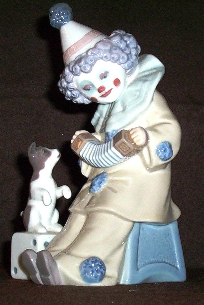 """Lladro figurine titled """"Pierrot with Concertina"""""""