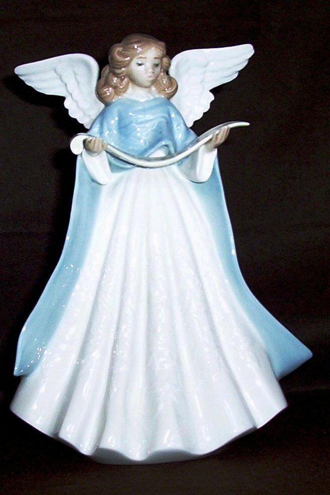 "Lladro figurine titled ""Blue Tree Topper"""