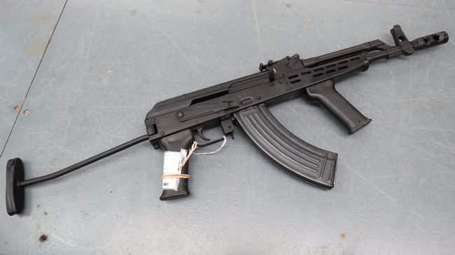 A deactivated AMD65 (AK47) rife and magazine in a black
