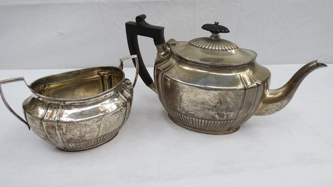 A Queen Anne style silver teapot with gadrooned base an